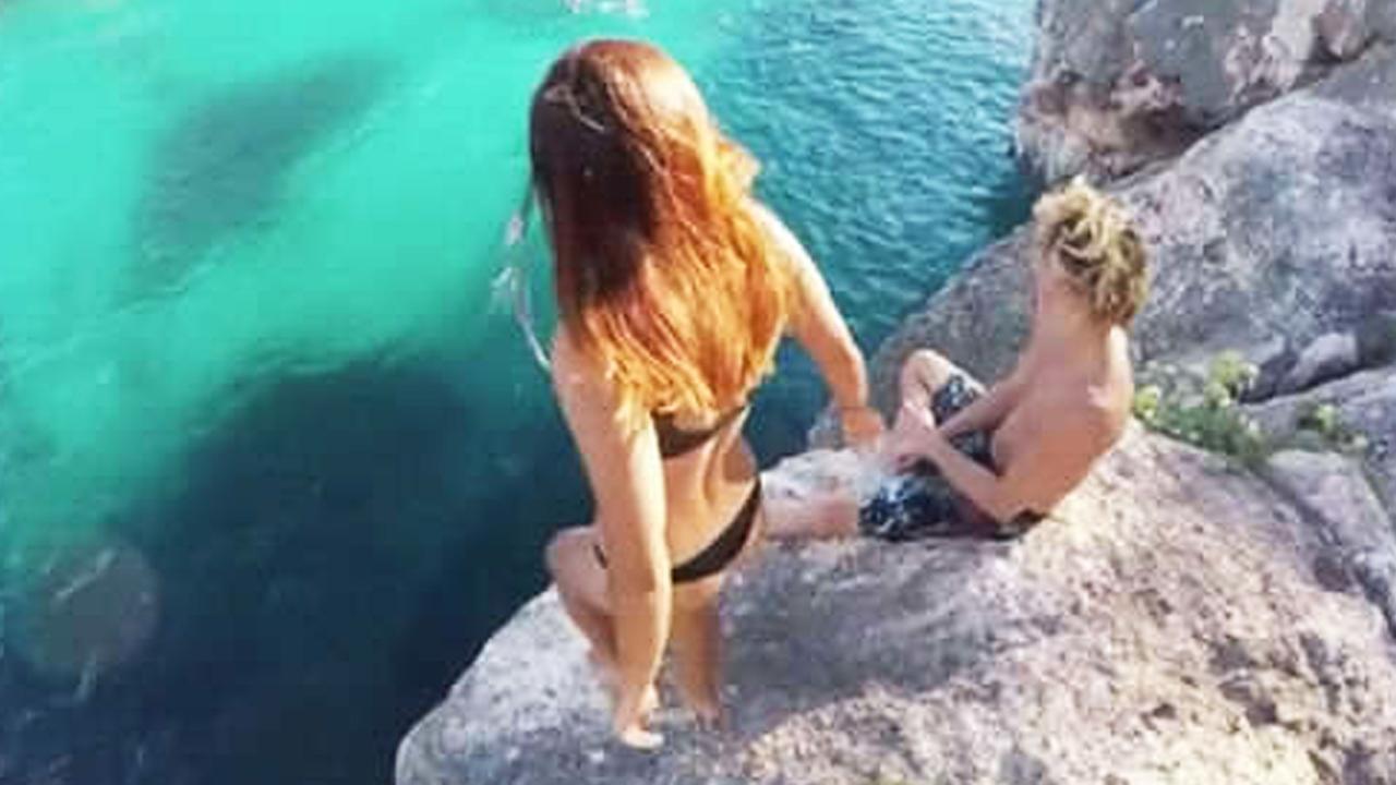 Internet in rep en roer nadat jongen zijn vriendin van klif laat vallen