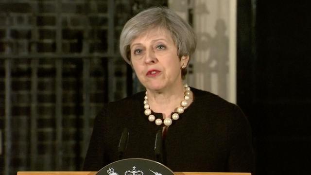 May: 'We zullen nooit toestaan dat het kwaad ons uit elkaar drijft'
