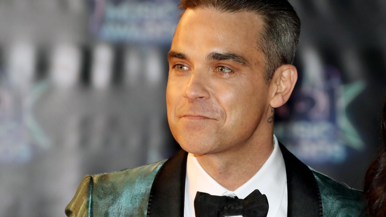 Dochter Robbie Williams maakt vader 'cameraklaar'