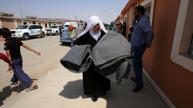 Evacuatie rebellen uit Damascus begonnen
