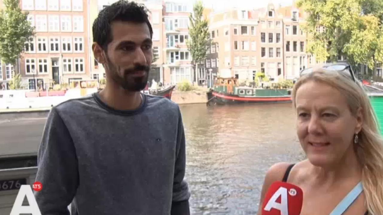 Vluchteling redt vrouw uit het water