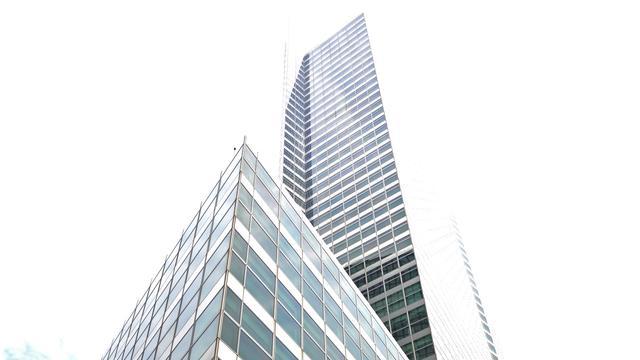 Schikking drukt winst Goldman Sachs