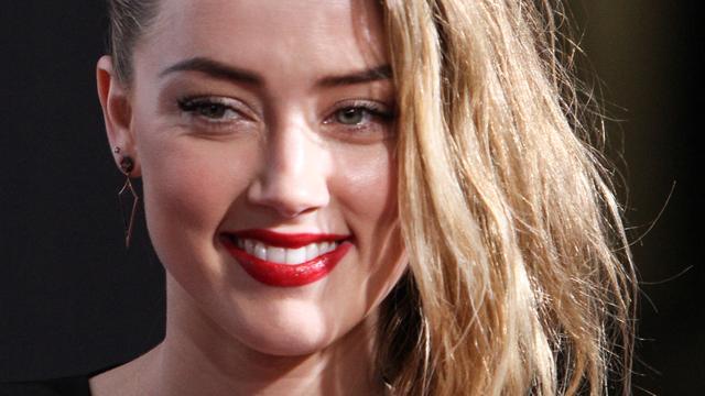 Amber Heard zet smaadzaak tegen komiek niet door