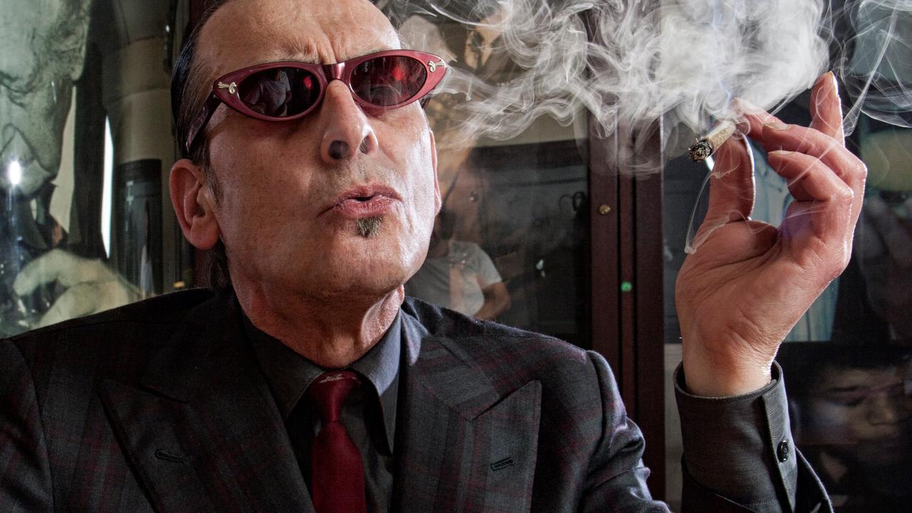 Jules Deelder smoking a cigarette (or weed)