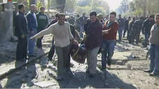 Syrische troepen vallen buitenwijk Damascus binnen
