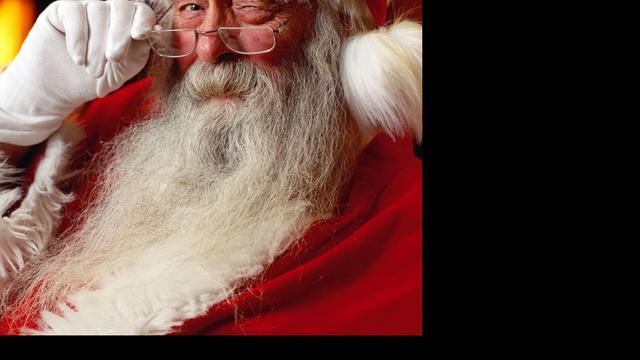 Kerstman hangt half uur aan baard in winkelcentrum