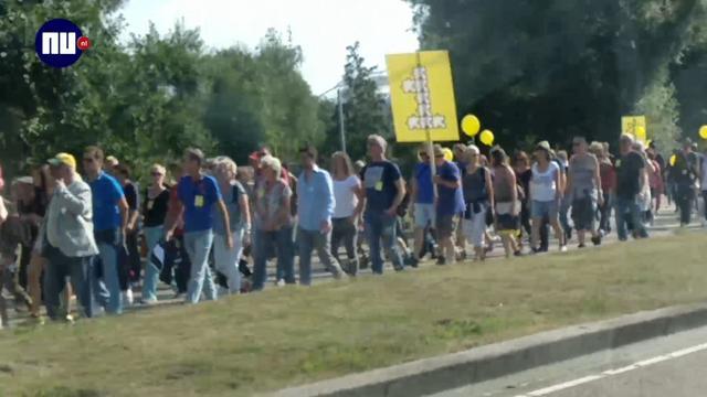 Duizenden mensen lopen parade voor diversiteit