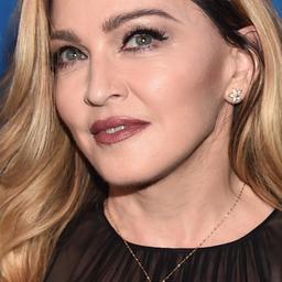 Madonna ontvangt schadevergoeding voor publicatie over adoptiedochters
