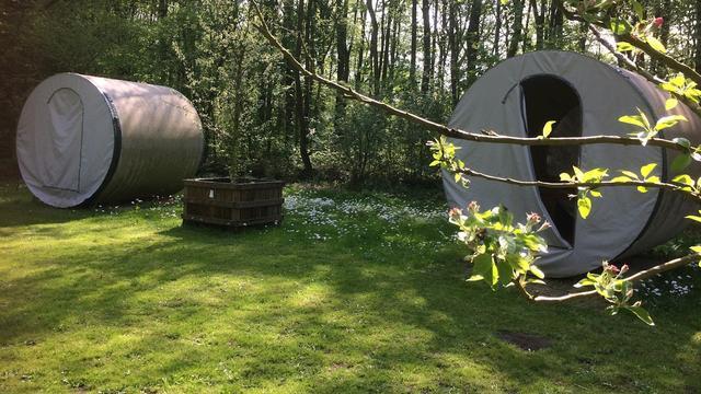 Op deze campings slaap je in een rioolbuis of tussen fruitbomen