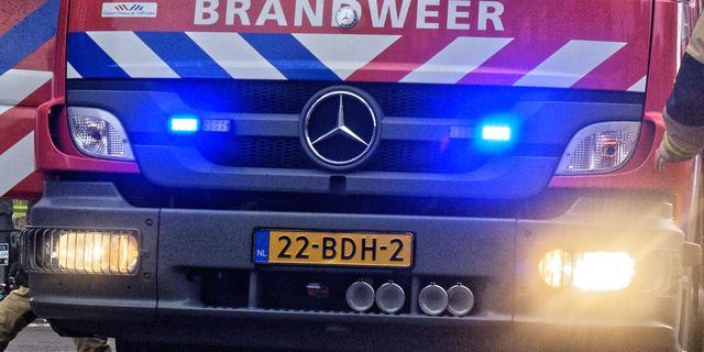 Bewoners springen uit raam bij brand in Amsterdam, buren leggen kussens neer