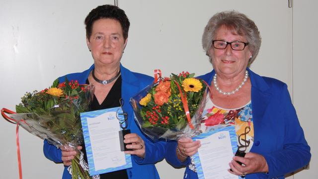 Twee leden Thoolse Canticum onderscheiden met koninklijk insigne