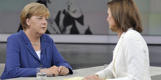 Merkel noemt migranten grotere uitdaging dan crisis Griekenland