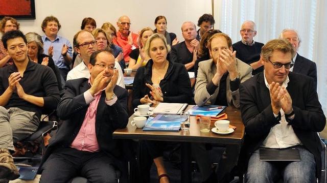 El Madkouri (links) tijdens een bijeenkomst in Nieuwspoort