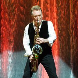 UB40-medeoprichter en -saxofonist Brian Travers op 62-jarige leeftijd overleden