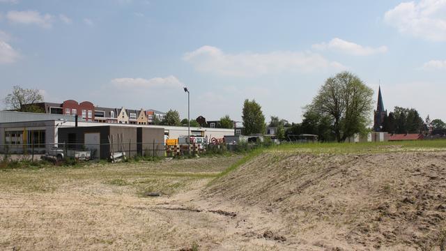 Supermarkten, woningen en park in Hoogerheide