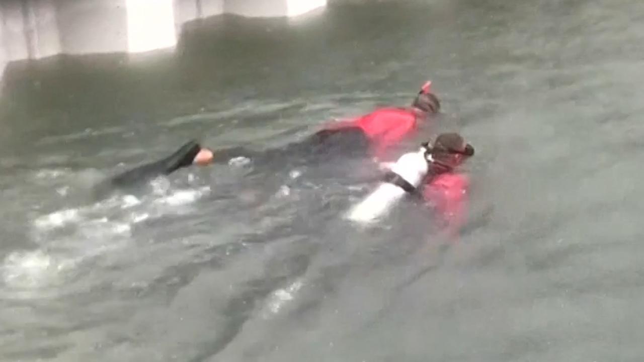 Duikers Rio zoeken na overstroming in tunnel naar slachtoffers