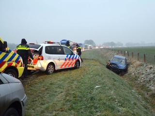 Auto's en vrachtwagens betrokken bij vele glijpartijen, code rood voor Drenthe en Friesland