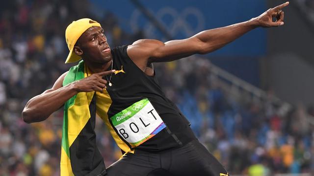 Bolt schrijft historie met derde olympische titel op 100 meter