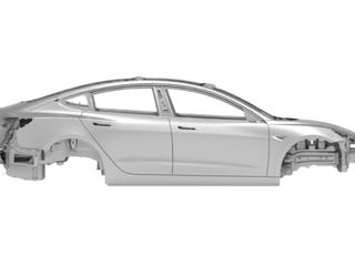 Foto verschenen waarop het koetswerk van de Tesla Model 3 te zien is