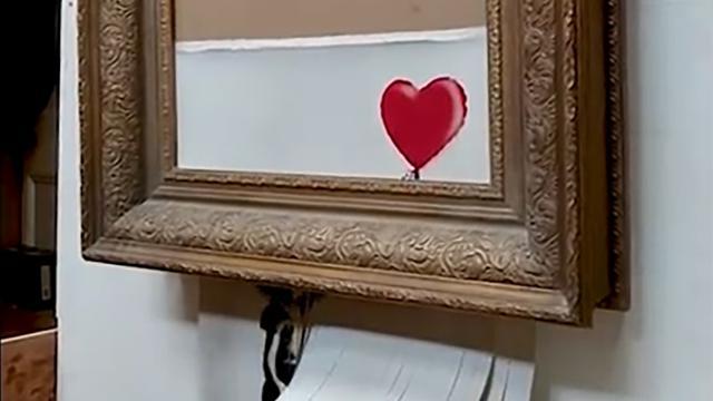 Banksy toont voorbereidingen op versnipperen kunstwerk