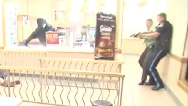 Beeld vrijgegeven van schietpartij waarbij 'Cops'-geluidsman omkwam