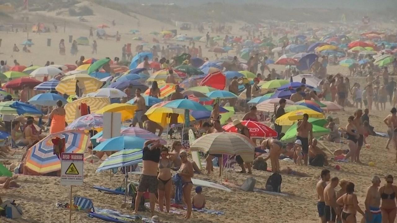 Spanjaarden en Portugezen zoeken verkoeling in hitte