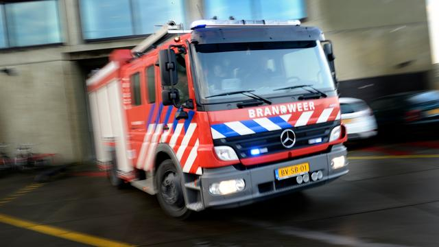 Grote brand legt autosloperij Uden in as