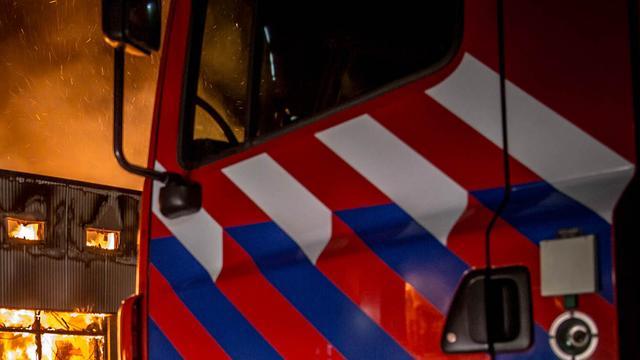 Grote brand bij autosloperij in Nijmegen