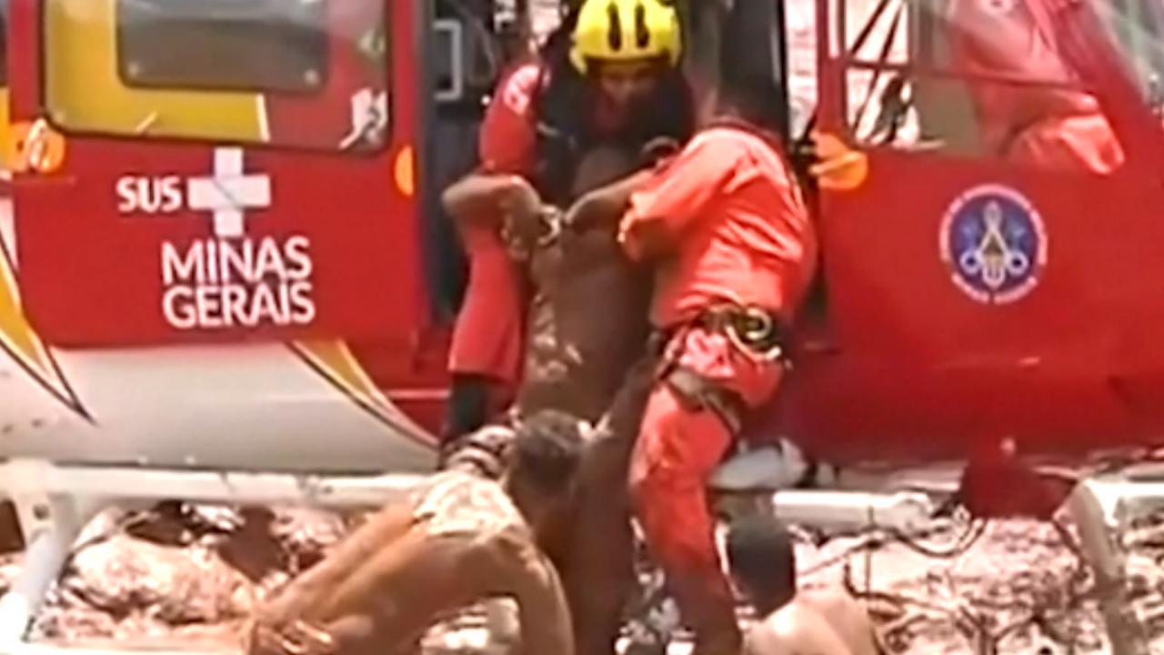 Brazilianen redden meisje na dambreuk uit modder