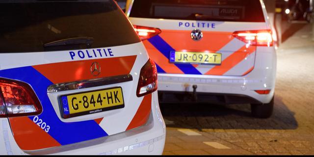 Drie personen aangehouden na botsing met politieauto op Stadhouderskade