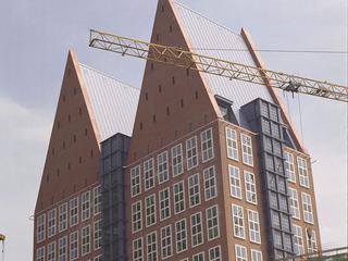 'Torens proberen wanhopig te passen bij de rest van de stad'