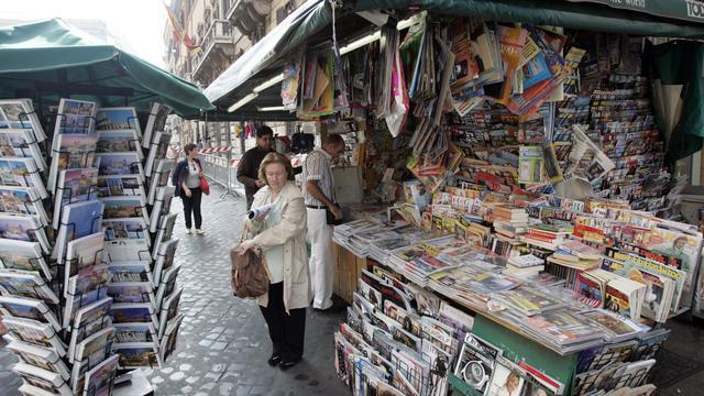 Belgische winkeliers eisen subsidie voor krantenverkoop