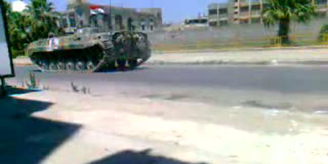 Syrische troepen omsingelen stad bij Homs