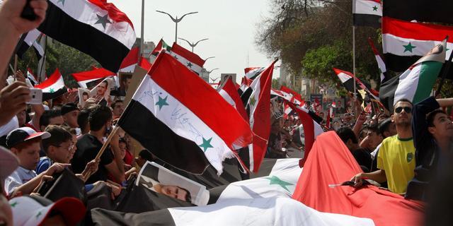 Syrische troepen doden activist