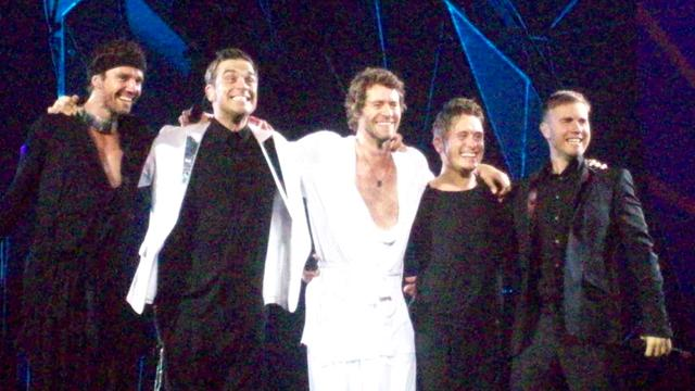Take That verrast Robbie Williams tijdens concert