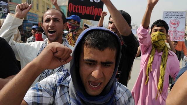 Afghanen herdenken invasie met betoging