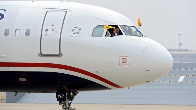 US Airways draait verlies door geplande overname