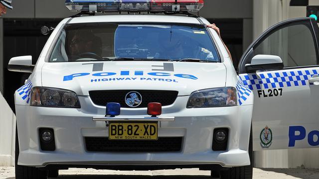 Australiër met verdacht pakket gijzelt kind