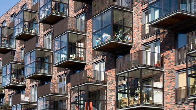 'Halveer sociale woningbouw Amsterdam'