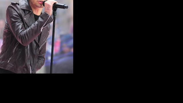 One Direction-zanger laat vriendin op arm tatoeëren