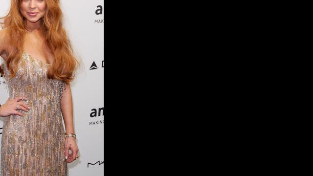 Lindsay Lohan slaat wodka achterover