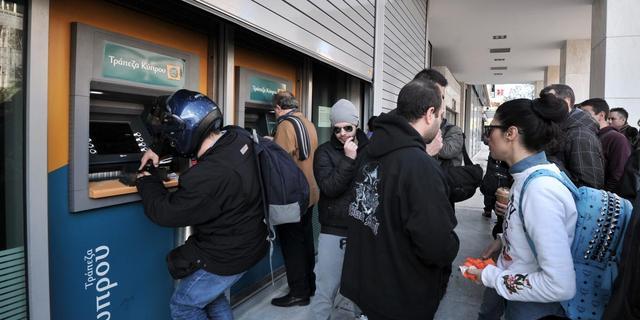 Banken Cyprus openen met zware beperkingen