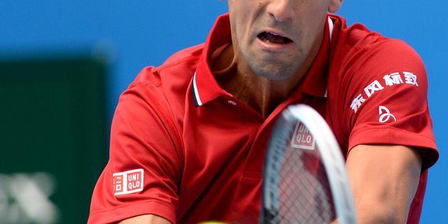 Djokovic naar kwartfinales in Peking, Wozniacki onderuit