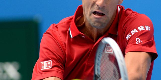 Novak Djokovic bereikt laatste acht in Peking