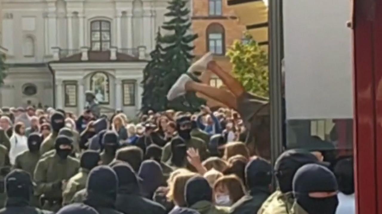 Belarusian police 'throw' women into arrest van