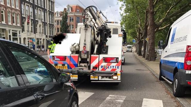 Chauffeur rijdt onwel geworden suikerpatiënt klem op Mauritskade