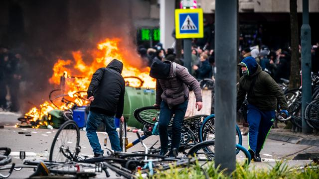Rioters drag bicycles during Sunday's riots in Eindhoven.