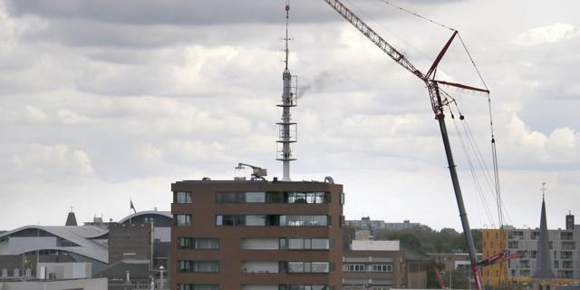 Persoon gered na brand in antennemast Oude Vest in Breda